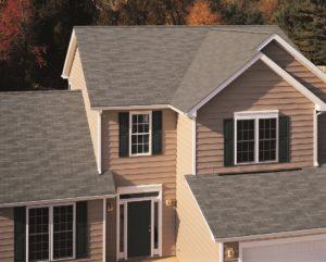 New grey asphalt shingle roof on large home.